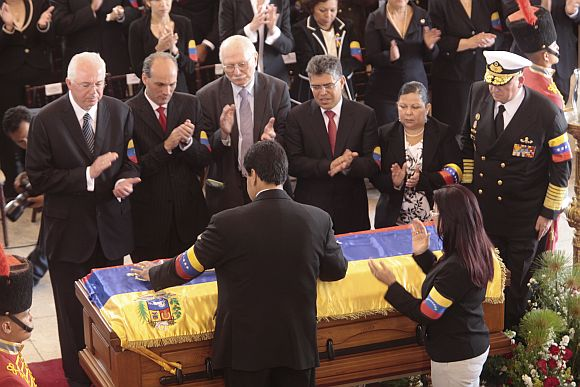Venezuela's Vice-President Nicolas Maduro presides over the funeral ceremony for Hugo Chavez at the military academy in Caracas on Friday.
