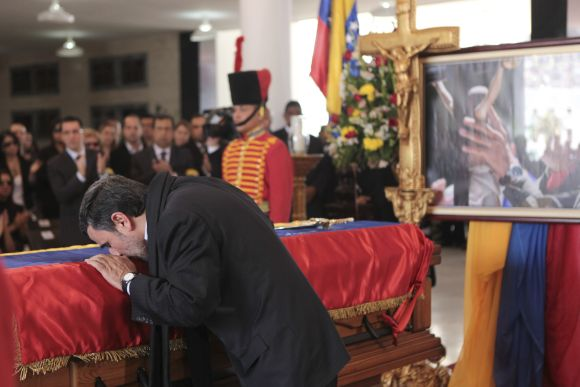 Iran's President Mahmoud Ahmadinejad pays tribute to Hugo Chavez, during the funeral service at the military academy in Caracas.