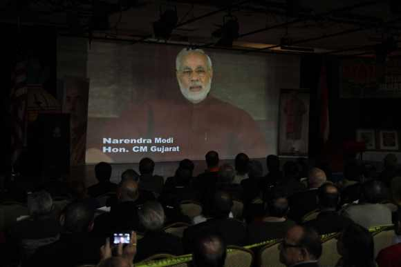 Indian Americans watch the video conference of Narendra Modi in New Jersey