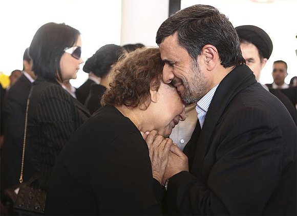 Iran's President Mahmoud Ahmadinejad offers his condolences to Elena Frias, mother of Venezuela's late President Hugo Chavez, during the funeral service at the Military Academy in Caracas