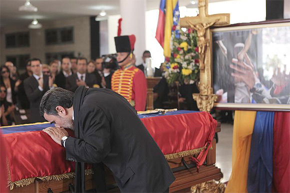 Mahmoud Ahmadinejad pays tribute to Hugo Chavez