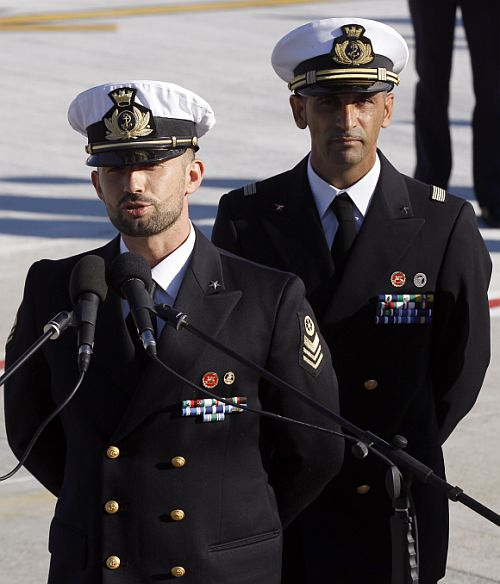 Italian marine Salvatore Girone (L) speaks to the media next to fellow marine Massimiliano Latorre after landing at Ciampino airport in Rome