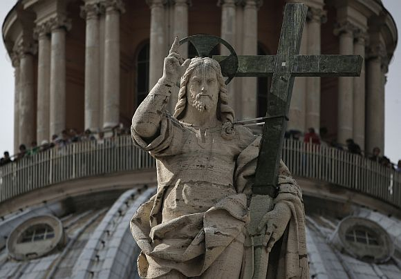 The statue of Jesus Christ at the dome of St Peter's Basilica at the Vatican.