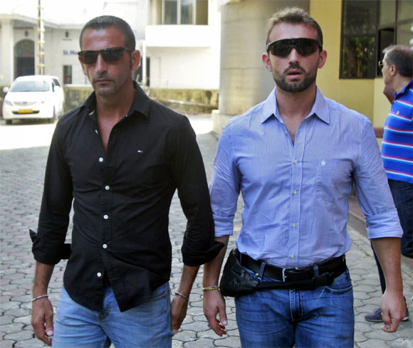 Italian sailors Salvatore Girone and Massimiliano Latorre leave the police commissioner's office in Kochi