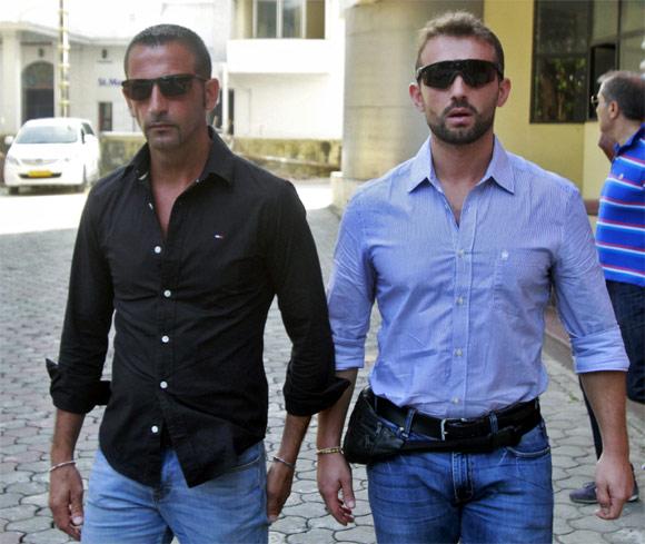 Italian sailors Salvatore Girone and Massimiliano Latorre leave the police commissioner's office in Kochi