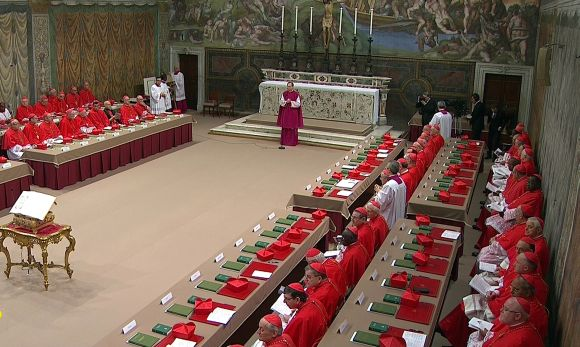 Cardinals sit in the Sistine Chapel to begin the conclave in order to elect a successor to Pope Benedict, in a still image taken from video at the Vatican