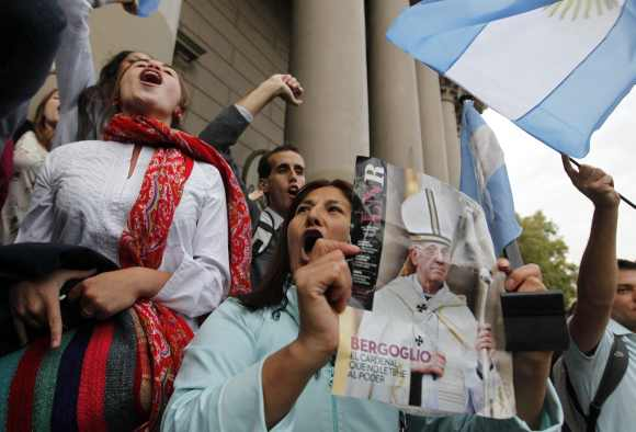 Roman Catholics celebrate the election of Argentine Cardinal Jorge Bergoglio as the new Pope, at the Metropolitan Cathedral in Buenos Aires