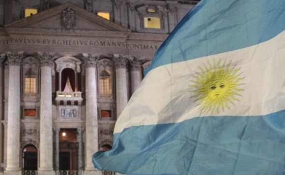 Faithful wave Argentina's flag after white smoke rose from the chimney above the Sistine Chapel