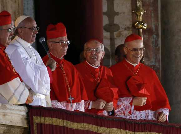 The Pope along with other cardianals on the St Peter's Basilica