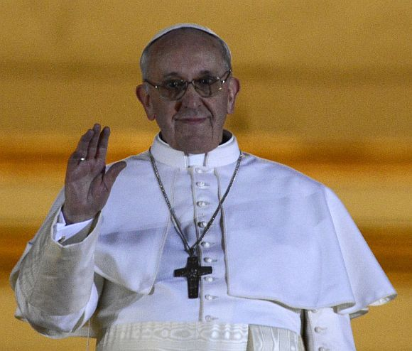 Newly elected Pope Francis, Cardinal Jorge Mario Bergoglio of Argentina appears on the balcony of St. Peter's Basilica after being elected by the conclave of cardinals
