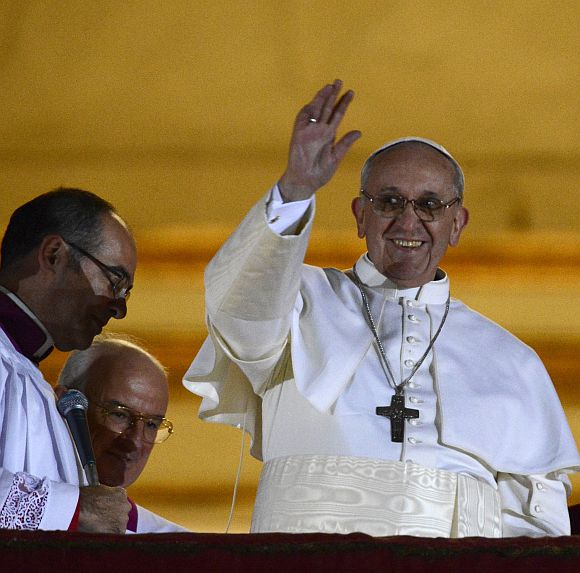 Newly elected Pope Francis, Cardinal Jorge Mario Bergoglio of Argentina appears on the balcony of St Peter's Basilica after being elected by the conclave of cardinals
