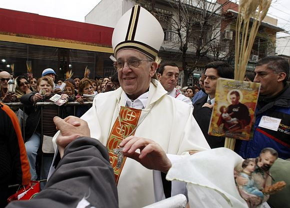 File photo shows Jorge Bergoglio, then Archbishop of Buenos Aires, greeting worshippers during the annual gathering and pilgrimage to the church dedicated to San Cayetano (Saint Cajetan), the patron saint of labor and bread, in the Buenos Aires neighbourhood of Liniers