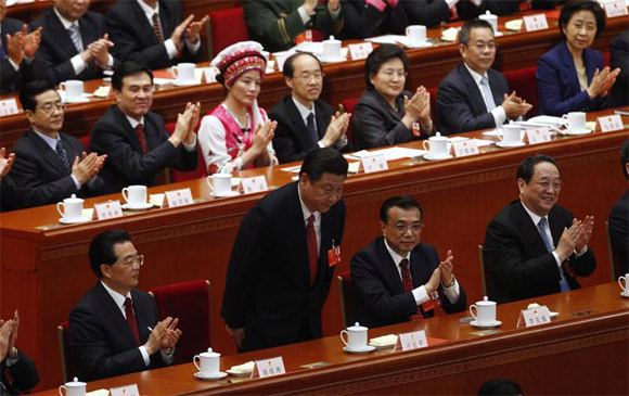 Jinping bows during the fourth plenary meeting of the National People's Congress
