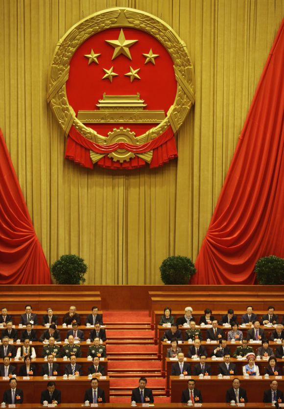 China's Politburo Standing Committee members, (1st row from L to R), Zhang Gaoli, Liu Yunshan, Zhang Dejiang, Xi Jinping, Li Keqiang, Yu Zhengsheng, Wang Qishan and other delegates attend the fifth plenary meeting of the National People's Congress in Beijing