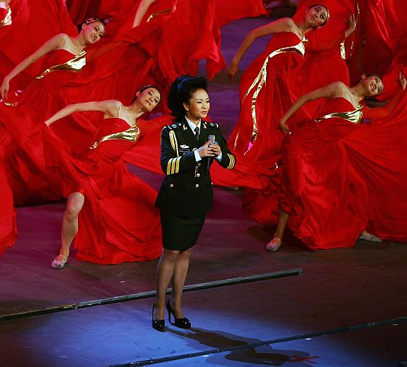 Vocalist Peng Liyuan, wife of Xi Jinping of the Central Secretariat of the Communist Party of China, sings army's song during the 'Red Army Flag' theatrical evening at the Great Hall of the People on July 30, 2007 in Beijing