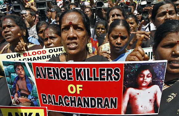 Demonstrators shout slogans as they hold placards during a protest against Sri Lanka's government in Chennai. Sri Lanka's government has faced heavy criticism after photographs obtained by Britain's Channel 4 suggested that 12-year-old Balachandran, son of Tamil Tiger leader Velupillai Prabhakaran, was murdered and not killed in crossfire during the chaotic end of the island's three-decade war. The government has denied killing Balachandran