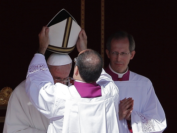 The papal mitre is placed on the head of Pope Francis during his inaugural mass in Saint Peter's Square at the Vatican.