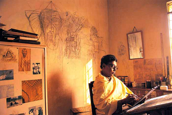 Legendary painter Ganesh Pyne immersed in his art.