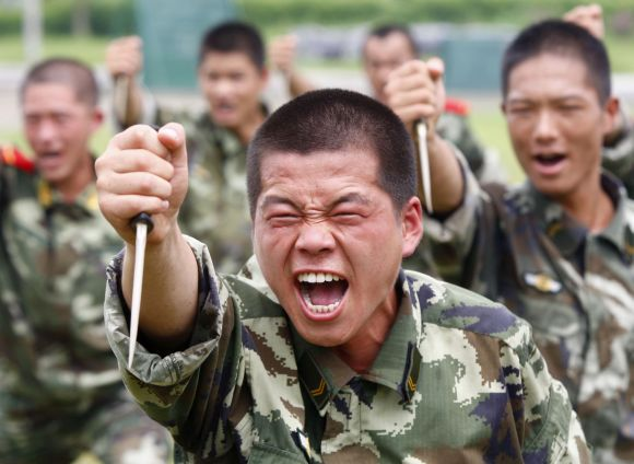Paramilitary police train with plastic daggers at a military base in Suining, Sichuan province