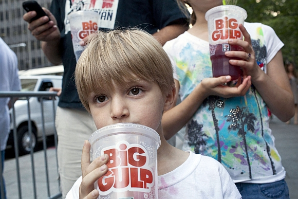 Benjamin Lesczynski, 8, of New York, takes a sip of a 'Big Gulp' while protesting the proposed 'soda-ban', that New York City Mayor Michael R Bloomberg has suggested, outside City Hall in New York