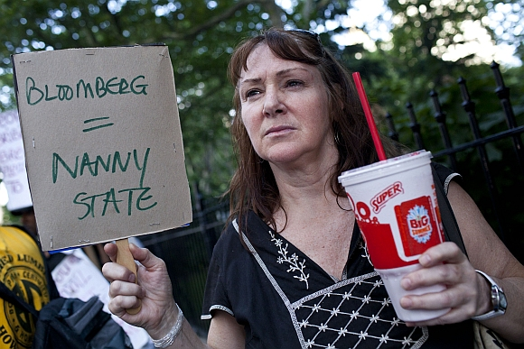 Andrea Hebert of New York, protests the proposed 'soda-ban', that New York City Mayor Michael R Bloomberg has suggested, outside City Hall in New York