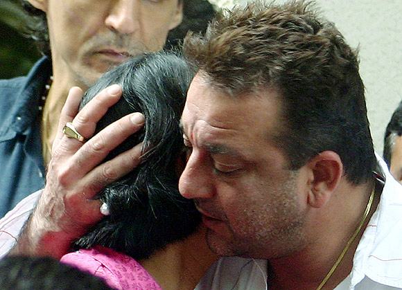 Dutt embraces his sister Priya Dutt at his residence before leaving to stand trial for the 1993 Mumbai blasts, in Mumbai July 31, 2007