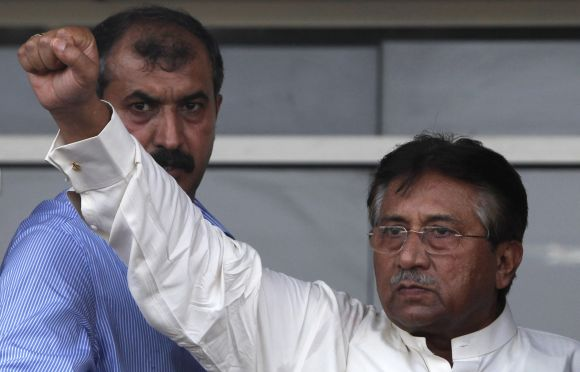 Pervez Musharraf gestures to his supporters upon his arrival from Dubai at Jinnah International airport in Karachi on Sunday