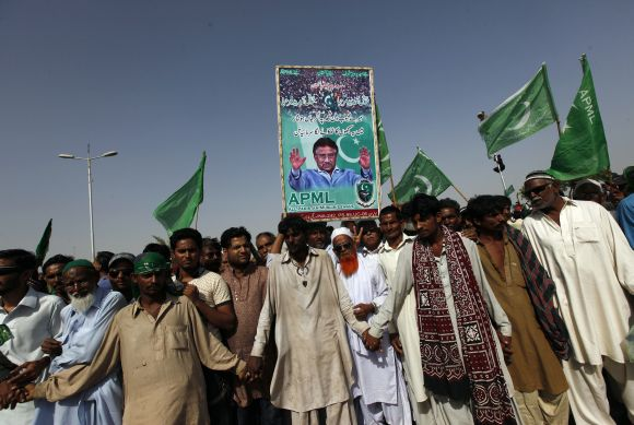 Supporters of Musharraf wait upon his arrival from Dubai at the Karachi airport