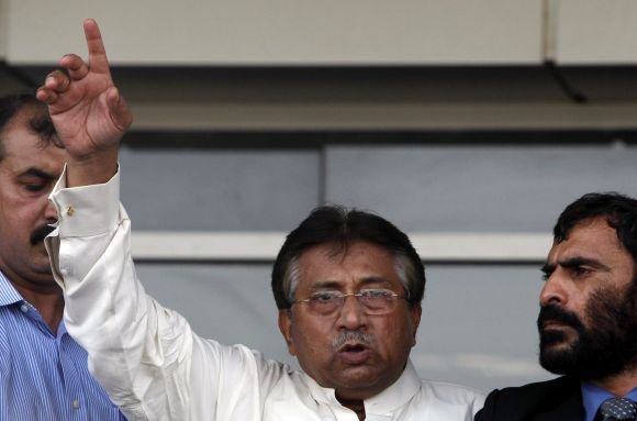 Musharraf addresses his supporters upon his arrival at the Karachi airport on Sunday