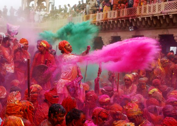 People celebrate Holi at UP's Nandgaon village on Saturday