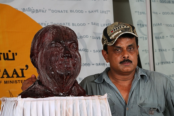 Shihan Hussaini with the sculpture