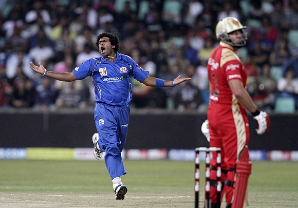 Mumbai Indians' Lasith Malinga, (left) reacts after nearly claiming the wicket of Royal Challengers Bangalore's Jacques Kallis during their Twenty20 cricket match at Kingsmead Stadium in Durban