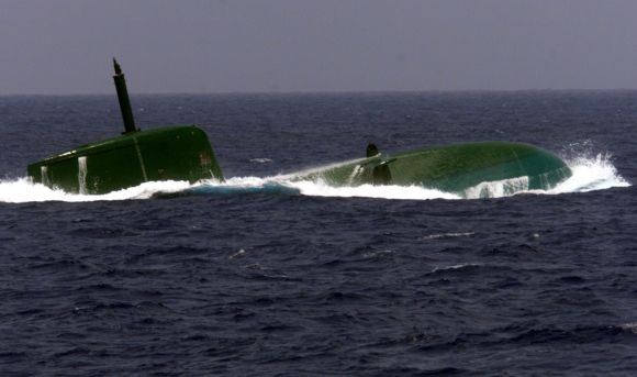 Israel's new Dolphin-class submarine surfaces in the Mediterrannean Sea. Israel received the first of three $300-million German-made submarines similar to models which, according to foreign reports, it has modified to carry cruise missiles with nuclear warheads.
