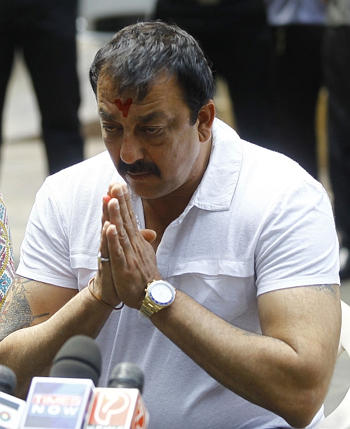 Bollywood actor Sanjay Dutt gestures during a news conference outside his residence in Mumbai