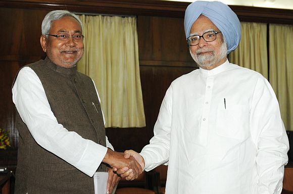 Bihar Chief minister Nitish Kumar with PM Singh