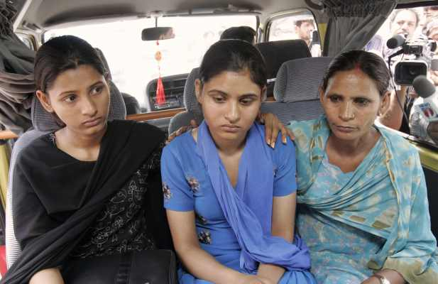 Sukhpreet Kaur, wife of Sarabjit Singh along with her daughters Swapandip and Poonam