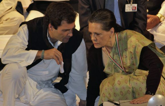 Rahul Gandhi speaks to Sonia Gandhi during the Indian National Congress meeting in Jaipur