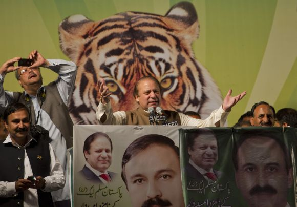 Nawaz Sharif (centre), leader of political party Pakistan Muslim League-Nawaz, addresses an election rally in Islamabad