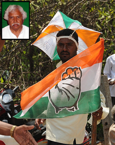 A Congress supporter poses with the party flag in Mysore after the election triumph in Karnataka on Wednesday. Inset: Madhusudan Mistry