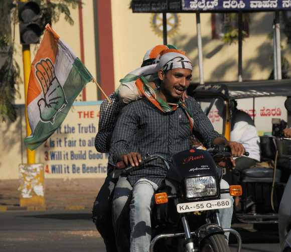 Congress supporters celebrate in Bengaluru on Wednesday