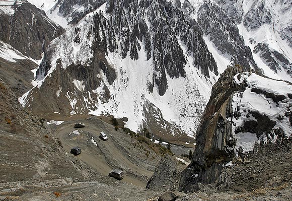 Vehicles make their way through a mountainous road on the Srinagar-Leh highway