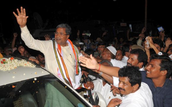 Karnataka Chief Minister Siddaramaiah waves out to supporters. Photograph: Madhusudhar S R