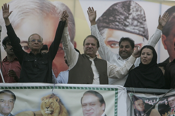 Nawaz Sharif cheers his supporters during an election campaign rally in Mandi Bahauddin, Punjab province