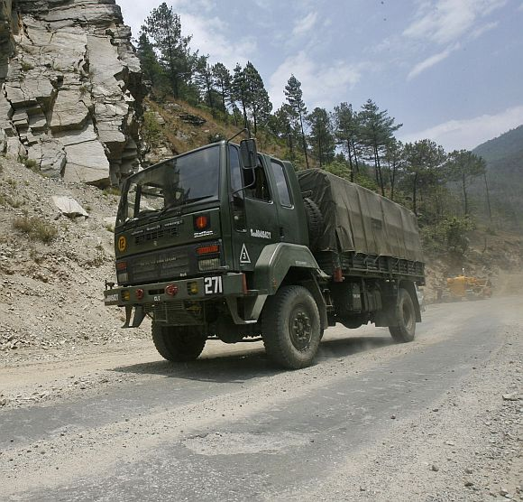 An Indian army truck drives along India's Tezpur-Tawang highway, which runs to the Chinese border