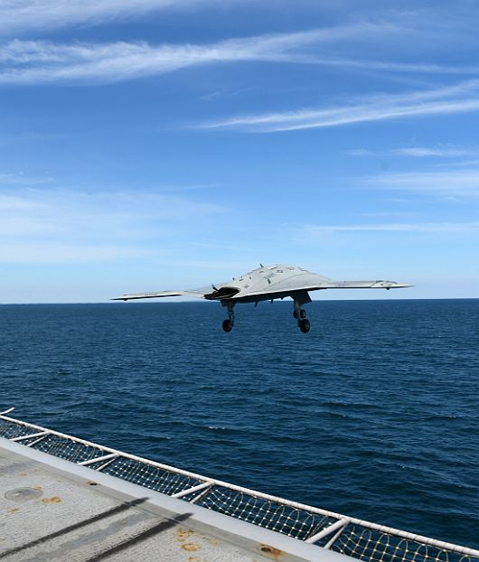 An X-47B Unmanned Combat Air System demonstrator launches from the flight deck of the aircraft carrier USS George H W Bush