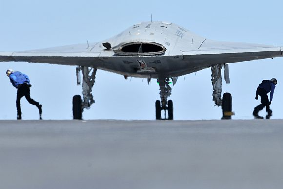 Sailors assigned to the aircraft carrier USS George H W Bush prepare to launch an X-47B Unmanned Combat Air System