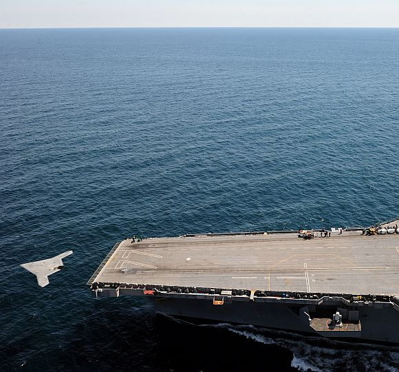 An X-47B Unmanned Combat Air System demonstrator launches from the flight deck of the aircraft carrier