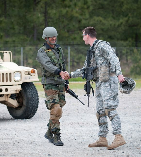 Indian Army Major Prashant Mishra, a company commander with 2nd Battalion, 5th Gurkha Rifles, 99th Mountain Brigade, is welcomed to a weapons range by Capt Cullen Lind, a company commander with the 82nd Airborne Division's 1st Brigade Combat Team