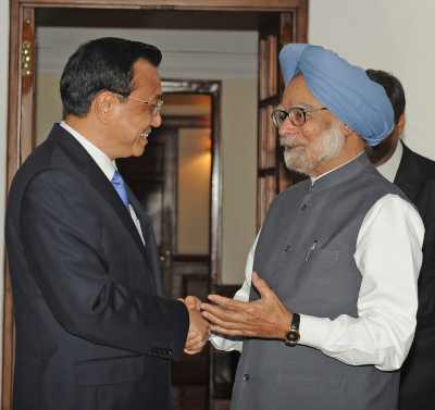 Prime Minister Manmohan Singh interacts with his Chinese counterpart Li Keqiang in New Delhi on Sunday