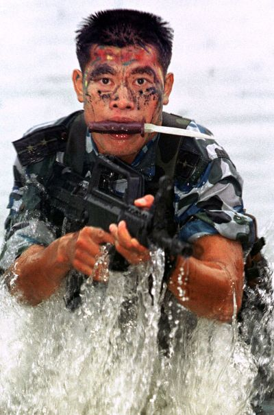 A Chinese marine goes through routine training at an undisclosed